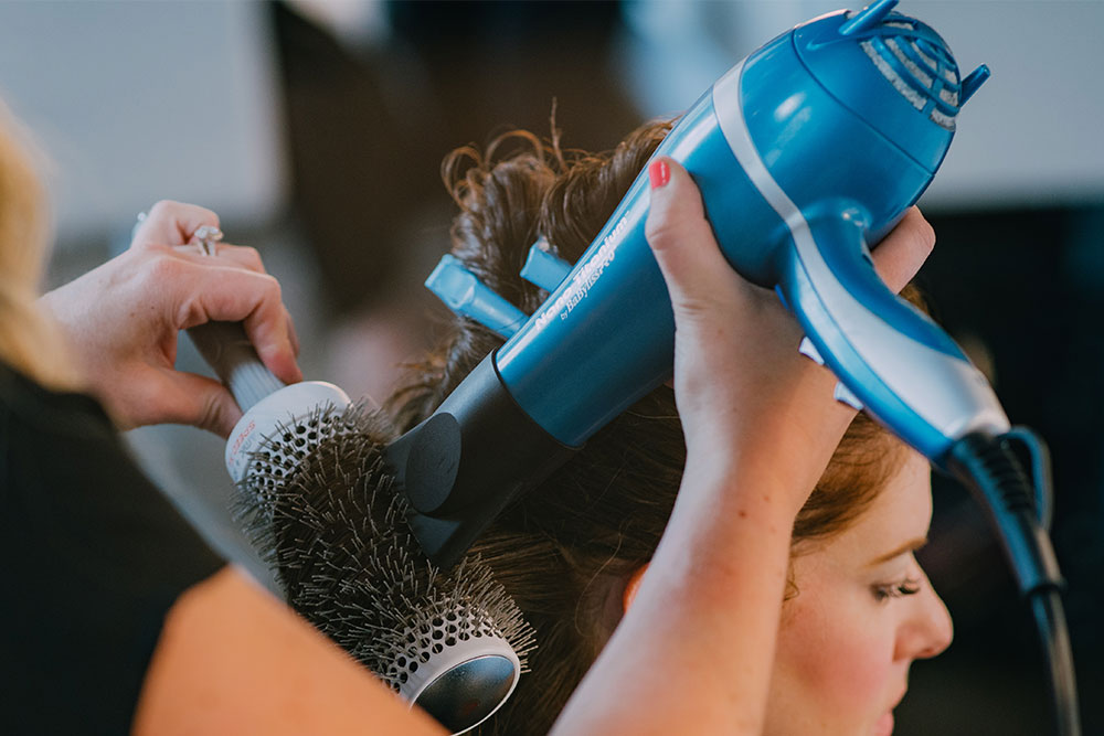 Stylist uses BaByliss Blow Dryer on a client